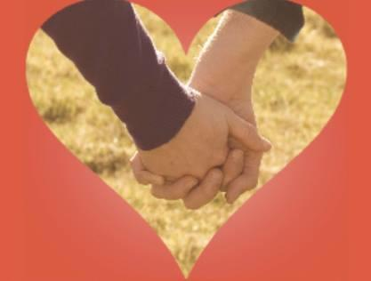 Holder i hender i hjerteramme